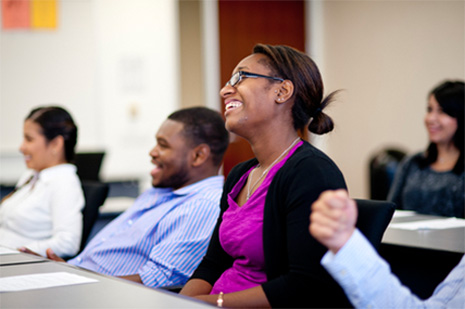 GSEP students smile in classroom - Pepperdine GSEP
