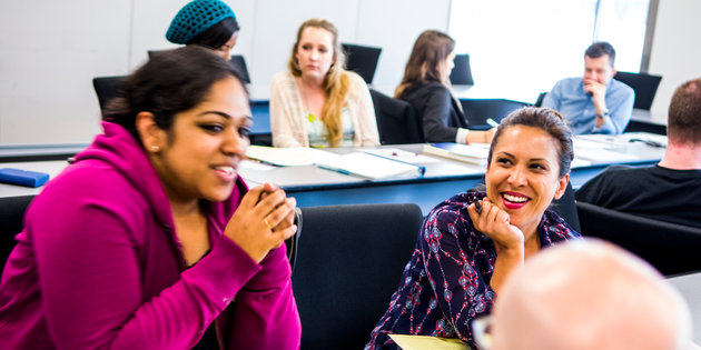 A group of women talk in class - Pepperdine GSEP