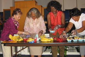 Women around a table with fruit - Pepperdine GSEP