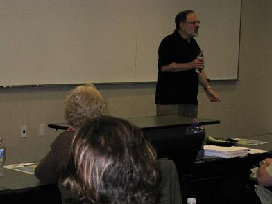 Dennis Palumbo speaks in front of a classroom - Pepperdine GSEP