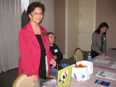 Woman standing up at CABE 2010 event - Pepperdine GSEP